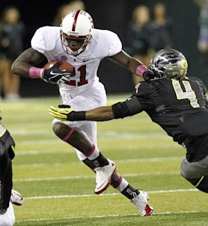 Stanford receiver Jamal-Rashad Patterson, left, tries to elude Oregon defender Erick Dargan during the first half of their NCAA college football game in Eugene, Ore., Saturday, Nov. 17, 2012.(AP Photo/Don Ryan)