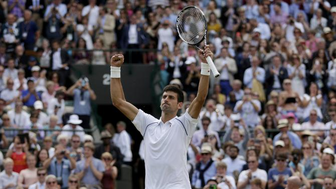 Novak Djokovic of Serbia celebrates after winning his match against Kevin Anderson of South Africa at the Wimbledon Tennis Championships in London