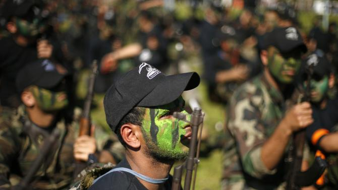 Palestinian youths take part in a military-style graduation ceremony after being trained at one of the Hamas-run Liberation Camps, in Gaza City