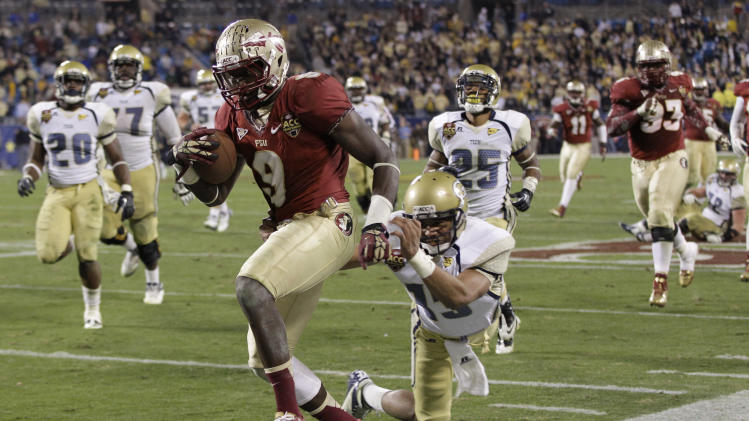 Florida State's Karlos Williams (9) returns an interception as Georgia Tech quarterback Tevin Washington (13) chases in vain during the second half of the ACC Championship college football game in Charlotte, N.C., Saturday, Dec. 1, 2012. Florida State won 21-15. (AP Photo/Chuck Burton)