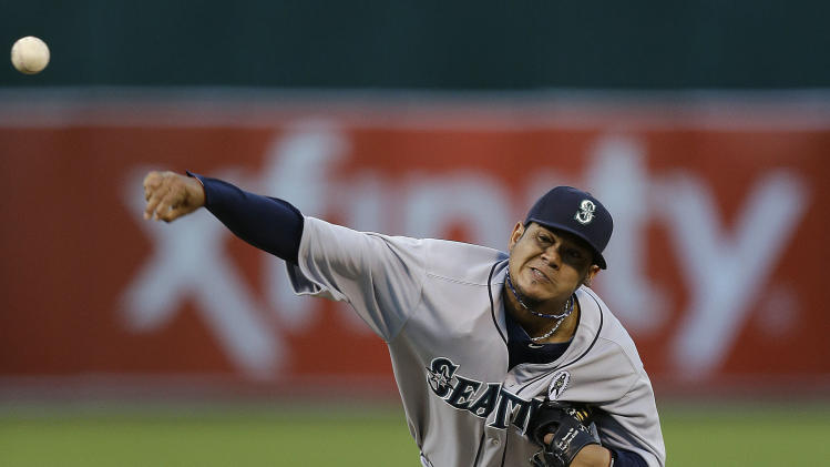 Seattle Mariners' Felix Hernandez works against the Oakland Athletics in the first inning of a baseball game Monday, April 1, 2013, in Oakland, Calif. (AP Photo/Ben Margot)