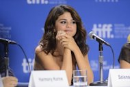 "Actress Selena Gomez speaks onstage at the ""Spring Breakers"" press conference during the 2012 Toronto International Film Festival at TIFF Bell Lightbox. Gomez stepped up Friday as the next Disney girl gone wild -- at least on screen -- in the sociopathic movie"
