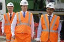 Britain&#039;s Chancellor of the Exchequer George Osborne, center, accompanied by India&#039;s Finance Minister Palaniappan Chidambaram, right, tour the Pudding Mill Lane Crossrail construction site, in east London, Thursday, May 16, 2013. (AP Photo/Lefteris Pitarakis, Pool)