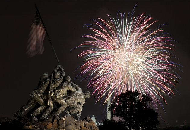The United States Marine Corps War Memorial, better known as the Iwo Jima Memorial, is seen in Arlington, Va., Monday July 4, 2011, as fireworks burst over Washington, during the annual Fourth of July