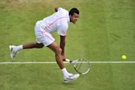 France's Jo-Wilfried Tsonga plays a shot during his men's singles quarter-final victory over Germany's Philipp Kohlschreiber on day nine of the 2012 Wimbledon Championships tennis tournament at the All England Tennis Club in Wimbledon, southwest London. Tsonga won the match