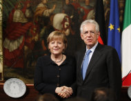 <p>               Italian Prime Minister Mario Monti, right, shakes hands with German Chancellor Angela Merkel during a press conference at Palazzo Chigi's government office, in Rome, Tuesday, March 13, 2012. Italian Premier Mario Monti, flanked by German leader Angela Merkel, says European Union focus must be on economic growth, even as the acute financial crisis seems to be easing. Monti, at a news conference with Merkel after the two held private talks in Rome Tuesday, said the EU must give the same attention to growth as it has to the debt crisis. (AP Photo/Alessandra Tarantino)