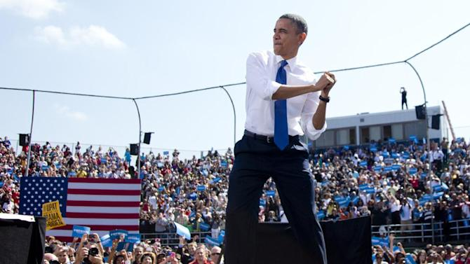 President Barack Obama swings with an imaginary bat as he arrives on stage to speak at a campaign event at  G. Richard Pfitzner Stadium, Friday, Sept. 21, 2012, in Woodbridge, Va. (AP Photo/Carolyn Kaster)