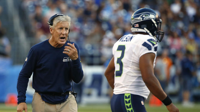 Seattle Seahawks head coach Pete Carroll, left, yells to quarterback Russell Wilson during the second half of a preseason NFL football game against the San Diego Chargers, Saturday, Aug. 29, 2015, in San Diego. (AP Photo/Lenny Ignelzi)