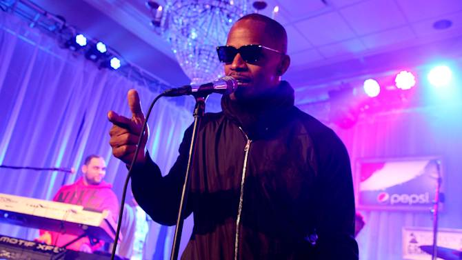 IMAGE DISTRIBUTED FOR PEPSI - Kamal Gray of The Roots and Jamie Foxx  perform at the Pepsi 5th Quarter in the French Quarter Post Super Bowl Party, on Sunday, Feb. 3, 2013, in New Orleans. (Photo by Barry Brecheisen/Invision for Pepsi/AP Images)