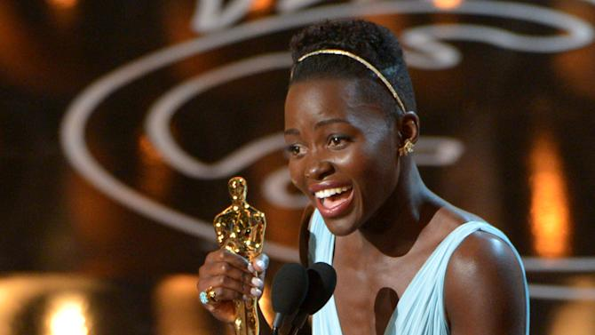 "Lupita Nyong'o accepts the award for best actress in a supporting role for ""12 Years a Slave"" during the Oscars at the Dolby Theatre on Sunday, March 2, 2014, in Los Angeles. (Photo by John Shearer/Invision/AP)"