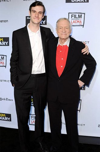 Cooper Hefner and Hugh Hefner at the Los Angeles premiere of The Rum Diary on October 13, 2011. Photo by Jon Koplaloff, Film Magic