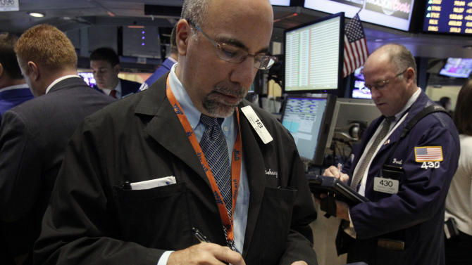 Trader John Liotti, left, works on the floor of the New York Stock Exchange Wednesday, Oct. 3, 2012. Stocks are mostly higher in early trading on Wall Street Wednesday after a measure of private sector hiring came in better than economists were expecting. (AP Photo/Richard Drew)
