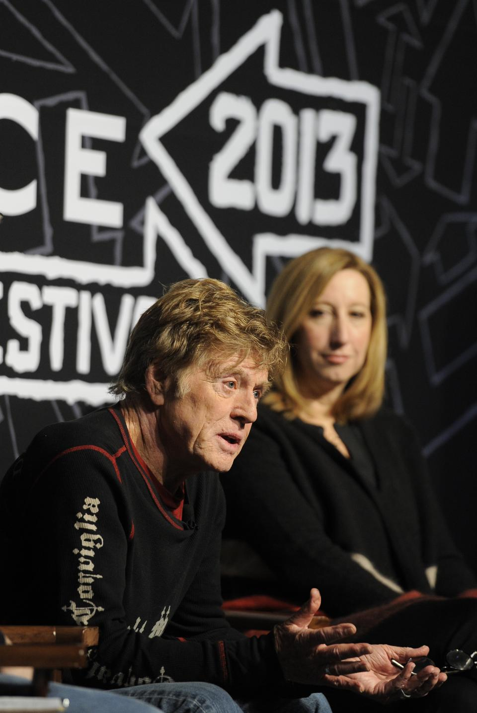 Robert Redford, left, founder and president of the Sundance Institute, speaks as Keri Putnam, executive director of the Sundance Institute, looks on during the opening news conference of the 2013 Sundance Film Festival, Thursday, Jan. 17, 2013, in Park City, Utah. (Photo by Chris Pizzello/Invision/AP)