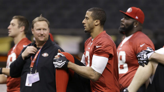 San Francisco 49ers quarterback Colin Kaepernick (7) warms up during practice in the Superdome on Saturday, Feb. 2, 2013, in New Orleans. The 49ers are scheduled to play the Baltimore Ravens in the NFL Super Bowl XLVII football game on Feb. 3. (AP Photo/Mark Humphrey)