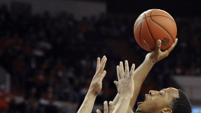 Miami's Kenny Kadji (35) shoots over Clemson's Milton Jennings (24) in the first half of an NCAA college basketball game, Sunday, Feb. 17, 2013, in Clemson, S.C. (AP Photo/Rainier Ehrhardt)