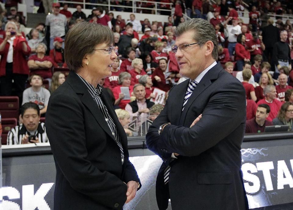 FILE - In this Dec. 29, 2012, file photo, Connecticut head coach Geno Auriemma, right, talks with Stanford head coach Tara Van Derveer before their NCAA college basketball game in Stanford, Calif. (AP Photo/Tony Avelar, File)