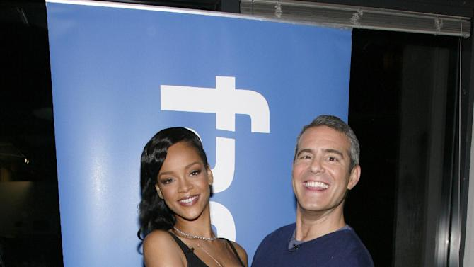 Recording artist Rihanna, left, and Andy Cohen of Bravo, right, pose before Rihanna's first ever Facebook Live chat, on Thursday, Nov. 8, 2012 at the Facebook Headquarters in New York. (Photo by Andy Kropa/Invision for Facebook/AP Images)