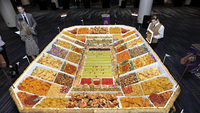 """IMAGE DISTRIBUTED FOR PILLSBURY - Pillsbury unveiled its Ultimate Snackadium at the Taste of the NFL's """"Party with a Purpose"""" in celebration of Americans' love of game day entertaining on Saturday, Feb. 2, 2013 in New Orleans. (G. Newman Lowrance/AP Images for Pillsbury)"""