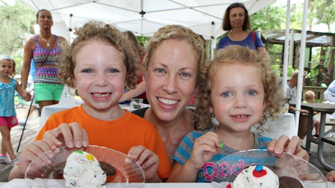 IMAGE DISTRIBUTED FOR BREYERS - Mother and two daughters display their ice cream masterpieces at the Breyers YummyFun Workshop, featuring culinary artist Clare Crespo, at the Central Florida Zoo, on Saturday, June, 29, 2013 in Sanford, Fla. For more information visit Breyers.com. (Photo by Alex Menendez/Invision for Breyers/AP Images)