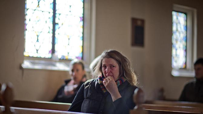Mary Fellows,of Newtown, Conn., weeps while waiting for a prayer service to begin at St John's Episcopal Church, Saturday, Dec. 15, 2012, in Newtown.  The massacre of 26 children and adults at Sandy Hook Elementary school elicited horror and soul-searching around the world even as it raised more basic questions about why the gunman, 20-year-old Adam Lanza, would have been driven to such a crime and how he chose his victims. (AP Photo/David Goldman)