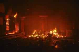 A Hindu temple burns after it was attacked in Larkana