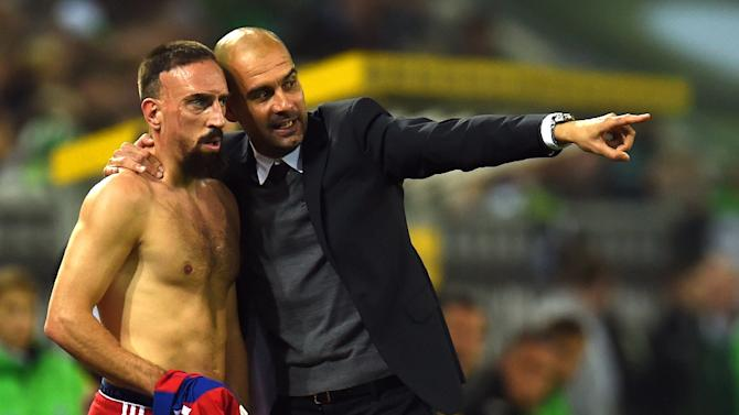 Bayern Munich coach Pep Guardiola (R) has stressed Franck Ribery, pictured here in October, must try to avoid picking up any red cards in their next Champions League match