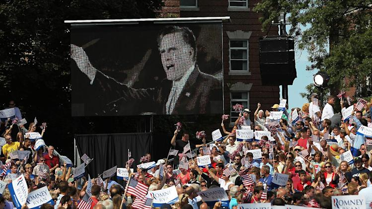 Republican presidential candidate, former Massachusetts Gov. Mitt Romney is seen on large screen as he and vice presidential candidate, Rep. Paul Ryan, R-Wis., attend a town hall at Saint Anselm College in Manchester, N.H., Monday, Aug. 20, 2012.  (AP Photo/Cheryl Senter)