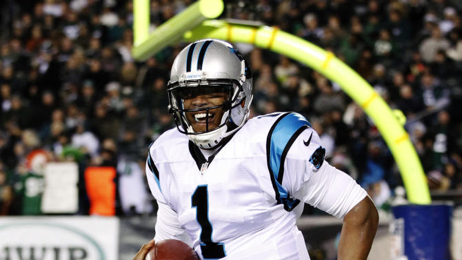 Carolina Panthers quarterback Cam Newton celebrates after throwing a touchdown pass in the first half of an NFL football game against the Philadelphia Eagles, Monday, Nov. 26, 2012, in Philadelphia. (AP Photo/Mel Evans)