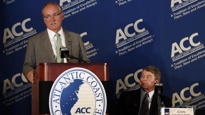 Notre Dame athletic director Jack Swarbrick, left, speaks as Atlantic Coast Conference commissioner John Swofford listens during a news conference at the University of North Carolina in Chapel Hill, N.C., Wednesday, Sept. 12, 2012. Notre Dame comes as close as it ever has in surrendering its independence in football, agreeing to play five games against the Atlantic Coast Conference every year and joining the burgeoning league in all other sports.  (AP Photo/Gerry Broome)