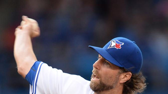 Toronto Blue Jays starting pitcher R.A. Dickey works against the Boston Red Sox during first inning American League baseball action in Toronto on Monday, June 29, 2015.  (Frank Gunn/The Canadian Press via AP) MANDATORY CREDIT