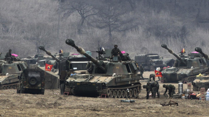 South Korean Marine K-55 self-propelled howitzer are parked during an exercise against possible attacks by North Korea near the border village of Panmunjom in Paju, South Korea  Monday, April 1, 2013. After weeks of war-like rhetoric, North Korean leader Kim Jong Un gathered legislators Monday for an annual spring parliamentary session taking place one day after top party officials adopted a statement declaring building nuclear weapons and the economy the nation's top priorities. (AP Photo/Ahn Young-joon)