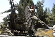 A Syrian rebel fighter loads an anti-aircraft gun in the northern town of Atareb, 25 kms east Aleppo, on July 31. Syrian President Bashar al-Assad said on Wednesday that the army was fighting for the nation's future as UN officials said the regime was using fighter jets against rebels armed with tanks