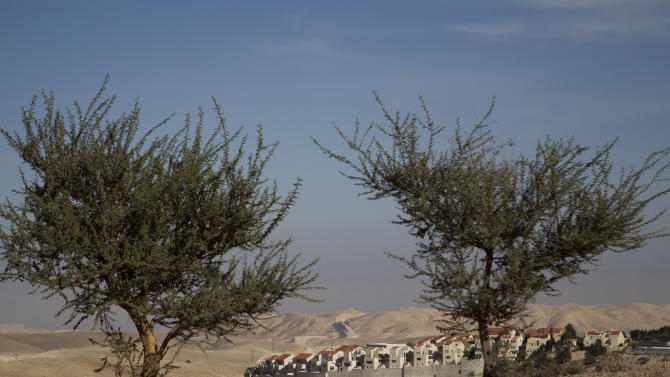 The E1 project at the Jewish West Bank settlement of Maaleh Adumim, near east Jerusalem, Sunday, Dec. 2, 2012. Israel on Sunday roundly rejected the United Nations' endorsement of an independent state of Palestine, and announced it would withhold more than $100 million owed to the Palestinians in retaliation for their successful statehood bid. Israel has a master plan to build 3,600 apartments and 10 hotels on the section of territory east of Jerusalem known as E1. The Palestinians have warned that such construction would kill any hope for the creation of a viable state of Palestine. (AP Photo/Ariel Schalit)