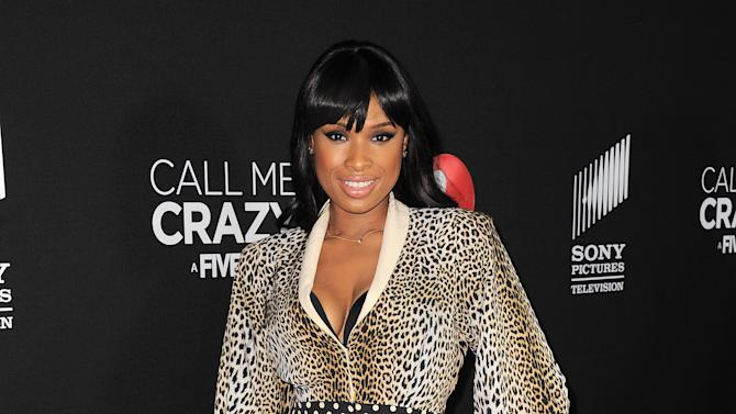 "FILE - In this April 16, 2013 file photo, Jennifer Hudson arrives at the world premiere of ""Call Me Crazy: A Five Film"" at the Pacific Design Center, in Los Angeles. Hudson and Christina Aguilera are among the artists set to pay tribute to this year's eclectic group of Rock and Roll Hall of Fame inductees. Aguilera and Hudson are scheduled to perform in honor of late disco queen Donna Summer at the 28th annual induction ceremony on Thursday, April 18, 2013, at the Nokia Theatre in Los Angeles.  (Photo by Jordan Strauss/Invision/AP, File)"