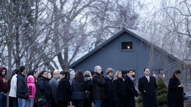 OLIVIA ENGEL, 6: People stand in line to enter a funeral home for calling hours for Olivia, in Newtown, Conn., Thursday, Dec. 20, 2012. (AP Photo/Seth Wenig)