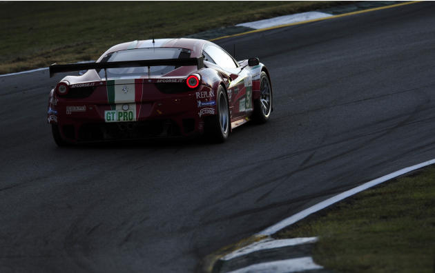 AF Corse Ferrari driver Gianmaria Bruni, of Italy, goes through a corner during the American Le Mans Series' Petit Le Mans auto race at Road Atlanta, Saturday, Oct. 1, 2011, in Braselton, Ga.  (AP Pho