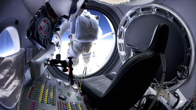 In this March 15, 2012, photo provided by Red Bull Stratos, pilot Felix Baumgartner of Austria prepares to jump at the first manned test flight for Red Bull Stratos in Roswell, N.M.  On Tuesday, Oct. 9, 2012, if winds allow, in the desert surrounding Roswell, Baumgartner will attempt to break Kittinger's world record for the highest and fastest free fall. (AP Photo/Red Bull Stratos, Jay Nemeth)