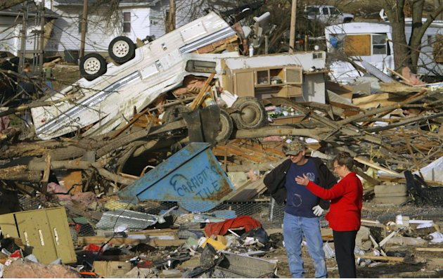 People try to salvage what they can after a tornado destroyed homes in their neighborhood Wednesday, Feb. 29, 2012, in Harrisburg, Ill. The tornado that blasted Harrisburg, killing six, was an EF4, th