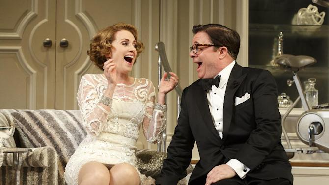 """In this image released by The O+M Company, Megan Mullally, left, and Nathan Lane appear during a performance of """"It's Only A Play,"""" in New York. Terrence McNally's comedy starring Lane, Mullally, Matthew Broderick and Stockard Channing, recouped its $3.9 million capitalization on Wednesday. (AP Photo/The O+M Company, Joan Marcus)"""
