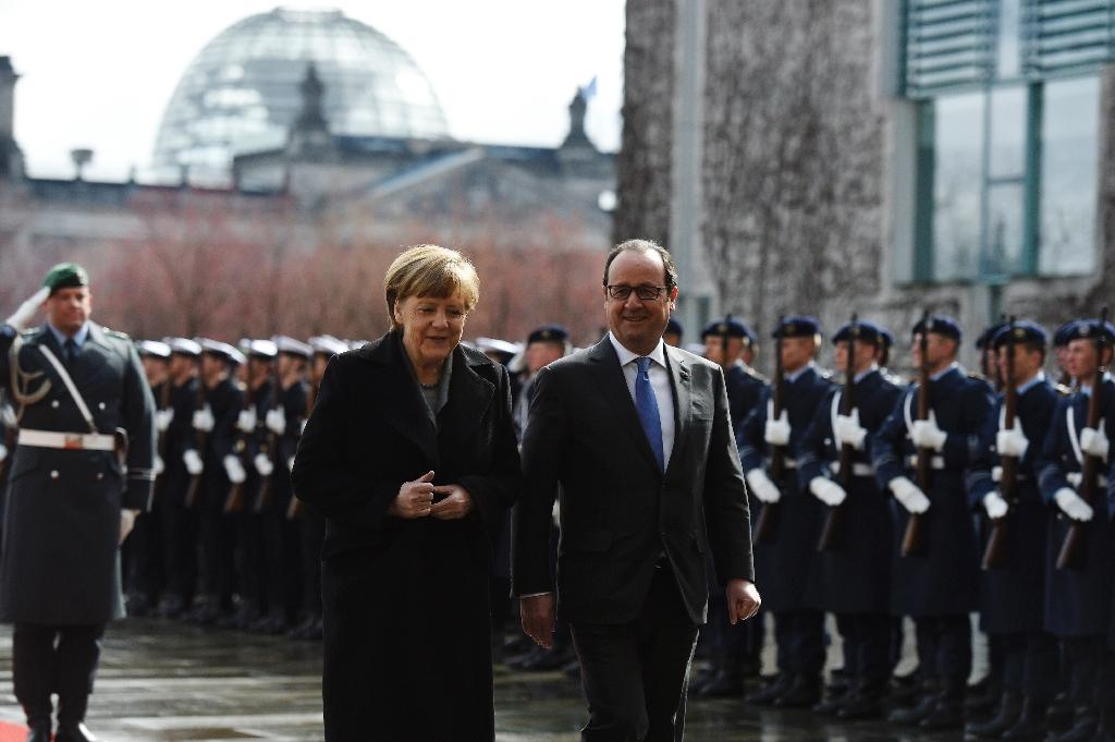 Hollande assures Berlin France will stick to reforms