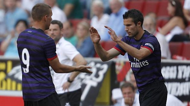 Robin van Persie replaces Lukas Podolski in a friendly against Cologne (Reuters)