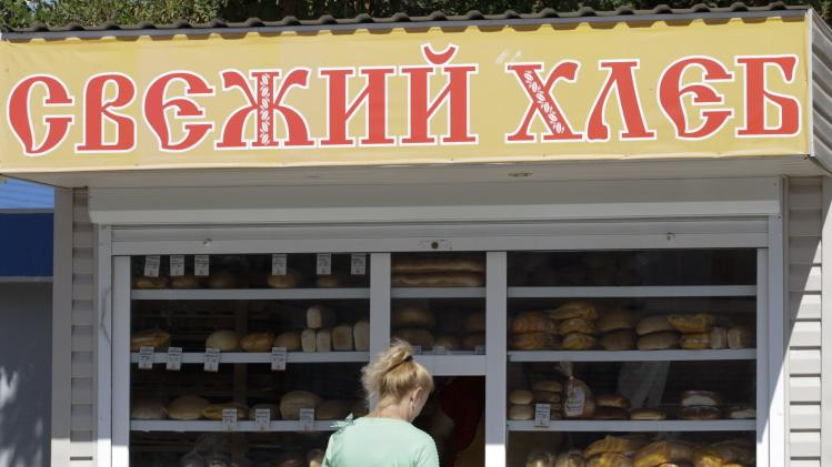 Woman buys bread in the southern coastal town of Novoazovsk