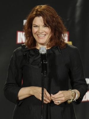 "FILE - In this April 4, 2009 file photo, singer Rosanne Cash speaks in the backstage during the 2009 Rock and Roll Hall of Fame Induction Ceremony in Cleveland. With a best-selling memoir and an album that never seemed to stop resonating with fans, Rosanne Cash celebrated the end of 2010 with a long break full of restful sleep. Cash is up for a Grammy Award for ""The List,"" her tribute to her iconic father, Johnny Cash. (AP Photo/Ron Schwane, file)"