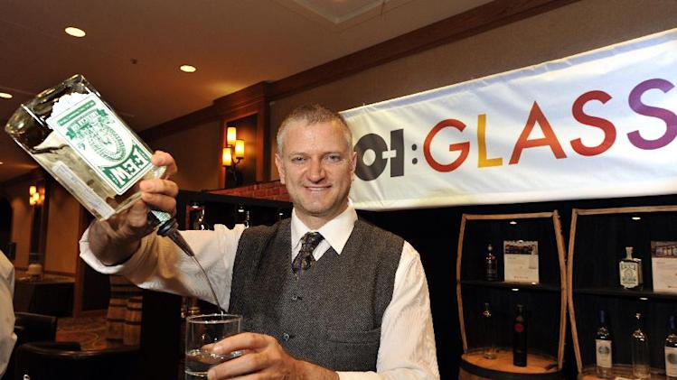 IMAGE DISTRIBUTED FOR OWENS-ILLINOIS - H. Joseph Ehrmann, renowned mixologist, pours FEW Spirits American Gin at glass container manufacturer Owens-Illinois' booth during the American Distilling Institute's 10th Anniversary Spirits Conference and Vendor Expo on Monday, April 1, 2013, in Denver. O-I is the world's largest glass container manufacturer and is the preferred partner for many of the world's leading food and beverage brands in addition to craft spirits. O-I's Glass Is Life movement promotes the widespread benefits of glass packaging around the globe.  (Jack Dempsey/AP Images for Owens-Illinois)