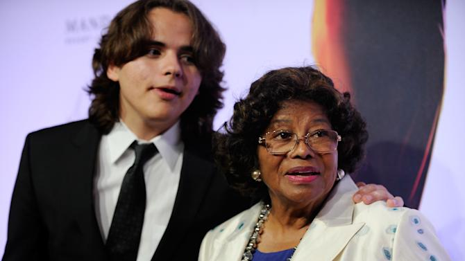 "FILE - In this June 29, 2013 file photo, Prince Jackson, left, and Katherine Jackson arrive at the world premiere of ""Michael Jackson ONE"" at THEhotel at Mandalay Bay Resort and Casino in Las Vegas. The Jackson family matriarch tearfully testified in a Los Angeles courtroom on Friday, July 19, 2013, about her son, Michael Jackson's death and her concerns about the pace of his planned comeback concerts. She is suing concert promoter AEG Live LLC, claiming it failed to properly investigate the doctor who administered a fatal dose of anesthetic to her son in June 2009. (Photo by David Becker/Invision/AP, File)"