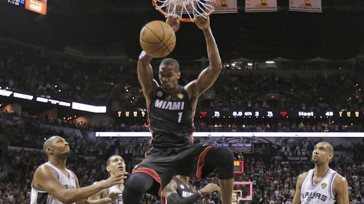 Miami Heat's Chris Bosh (1) dunks against the San Antonio Spurs during the first half at Game 4 of the NBA Finals basketball series, Thursday, June 13, 2013, in San Antonio. (AP Photo/Eric Gay)