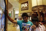 Cinema-goers watch a movie trailer at a PVR Multiplex in Mumbai November 10, 2013. REUTERS/Danish Siddiqui