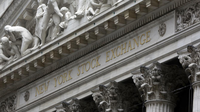 FILE - This Oct. 2, 2014 file photo shows the facade of the New York Stock Exchange, in New York. U.S. stocks are opening slightly higher Friday, Dec. 26, 2014, in relatively quiet trading the day after Christmas. (AP Photo/Richard Drew, File)