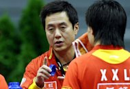China&#39;s table tennis head coach, pictured in 2007, blasted his rivals on Monday, claiming a stronger work ethic will guarantee his players remain top of the international pile