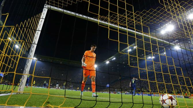 Arsenal's Szczesny collects ball from net after goal scored by Dortmund in Champions League soccer match in Dortmund